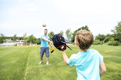 Dad and son playing catch with a baseball